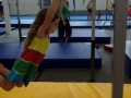 young kids swinging in the gym