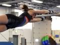gymnast reaching for bar