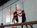 kids on balance beam in gym