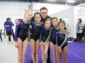 coach with teen gymnasts