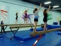 young teens on balance beam