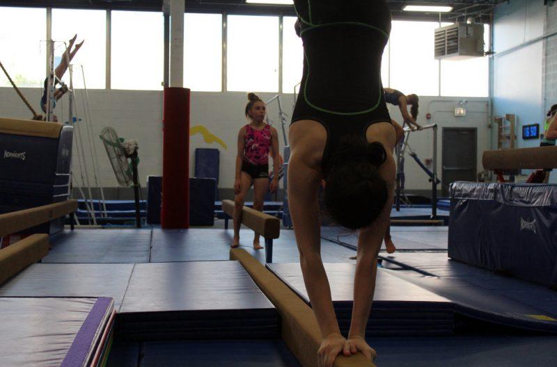 Gymnastics Handstand on Balance Beam