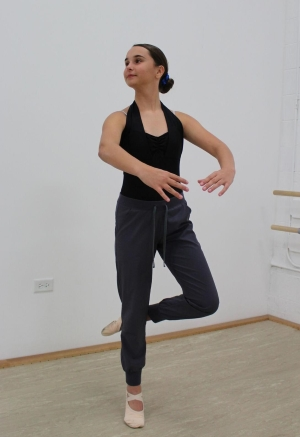 Young Woman Practicing Dance Moves Spotting